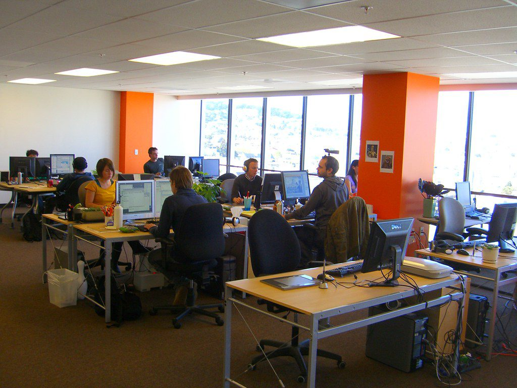 People coworking in an open office design studio in San Fransisco