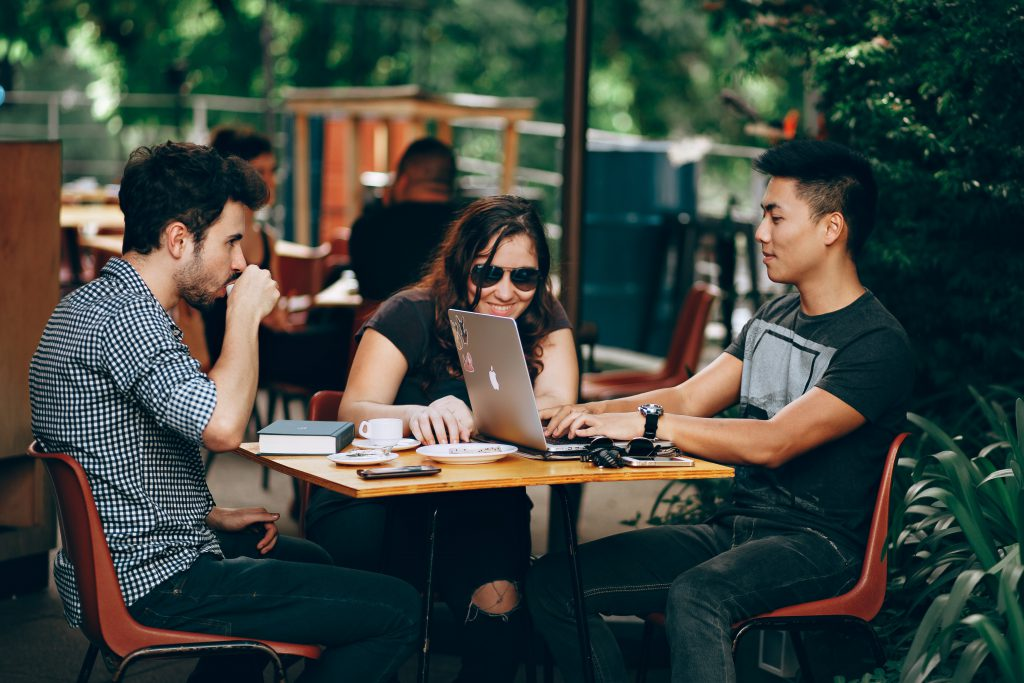Group of young adults collaborating with coffee
